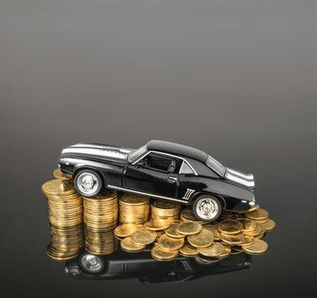 mount price: money concept. car on coins.