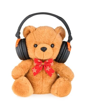 soft background: Teddy bear with headphones isolated on white
