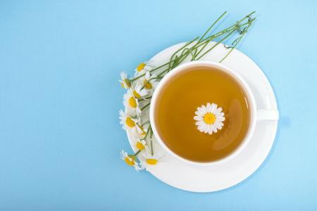 chamomiles: Cup of tea and chamomiles Stock Photo