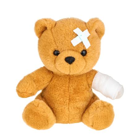 Teddy bear with bandage isolated on white