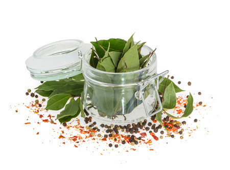 Bay leaves and spices isolated on a white