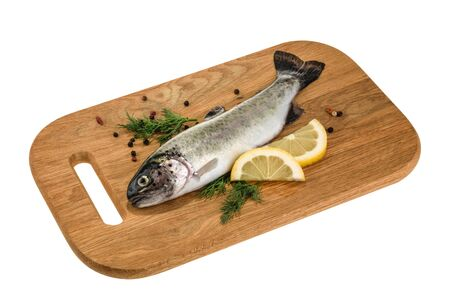 Trout fish on wooden board isolated without shadow