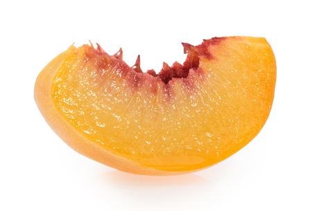 Peach slice isolated on white background