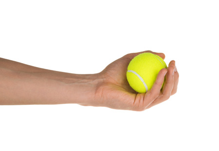 hand holding tennis ball isolated on white clipping path