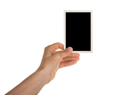 Hand hält Fotorahmen isoliert auf weiss mit Beschneidungspfad Standard-Bild