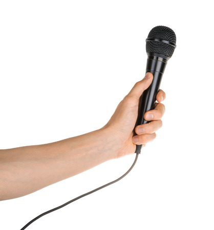 Hand holding microphone isolated on white clipping path
