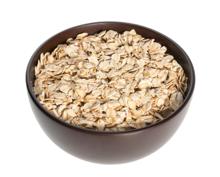 Rolled oats, healthy breakfast cereal oat flakes isolated on white
