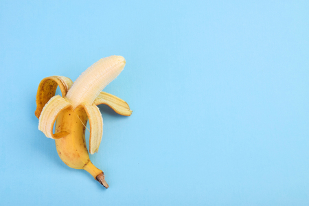 Banana on blue background top view