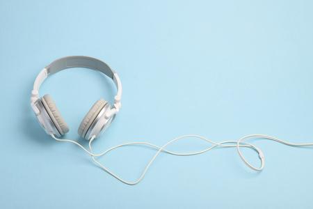 Headphones on blue pastel background Reklamní fotografie