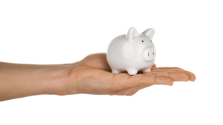 Hand holding piggy bank isolated on white clipping path Reklamní fotografie