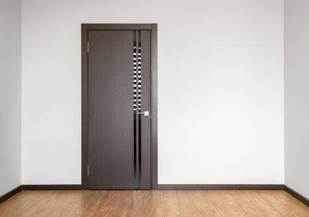wooden door in empty room copy space photography