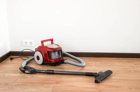 vacuum cleaner is standing on the floor Stock Photo