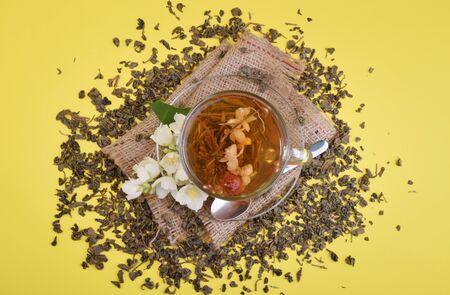 Cup of jasmine tea with flowers top view Stock fotó