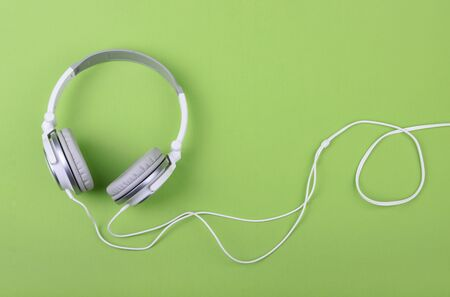 Headphones on green background copy space Stock fotó