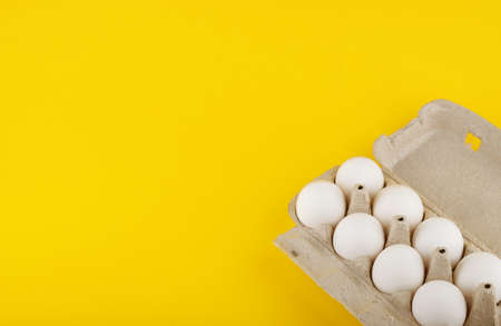 chicken eggs on yellow background