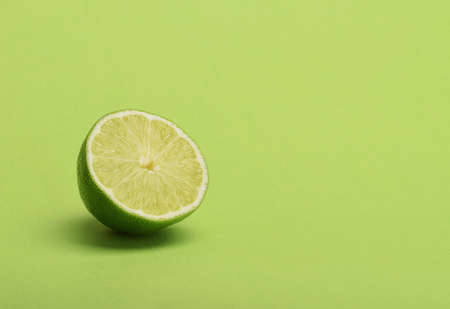 Lime slice on green background