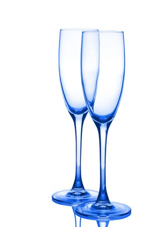 bar ware: Two dark blue glasses for champagne. Isolated on a white background. Stock Photo