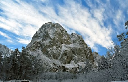 impregnable: Unapproachable snow-covered rock.