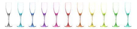 bar ware: Set of multi-coloured glasses for champagne: red, orange, yellow, green, blue, dark blue, violet, pink, aquamarine, grey, citril. Over white. Stock Photo