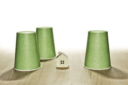 and guessing: Cup And House Guessing Game Stock Photo