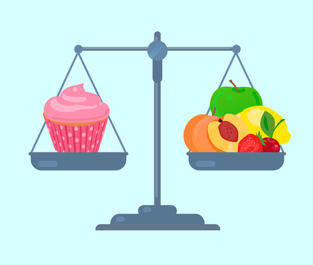 Fruits and cupcake on scales