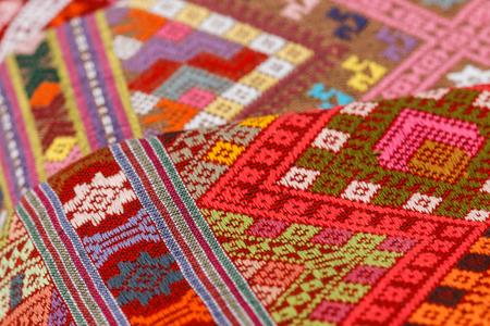 Hand-woven fabrics, texture of thai style fabric weave. Imagens