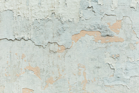 The texture of the mottled shabby wall, painted blue and gray plaster, abstract background close-up