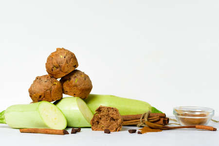 chocolate muffins with zucchini and banana. wet veggie cupcakes home-made, top view on a light background. cooking muffins in the kitchen. in the split view.