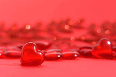 valentine's day mockup greeting card with red hearts on red background, for text place. festive wedding background, bluer focus. Standard-Bild