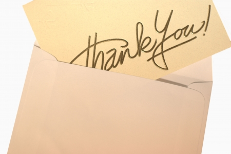 an envelope with a thank you card in it photo