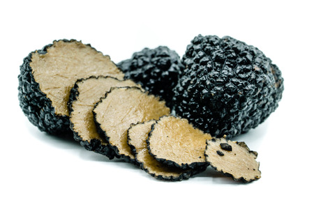 Two black truffles and one truffles sliced ??isolated on white background