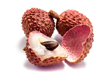 Two litchi fruits and one sliced ??isolated on white background