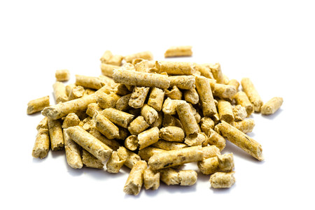 Pile of wood pellets isolated on white background