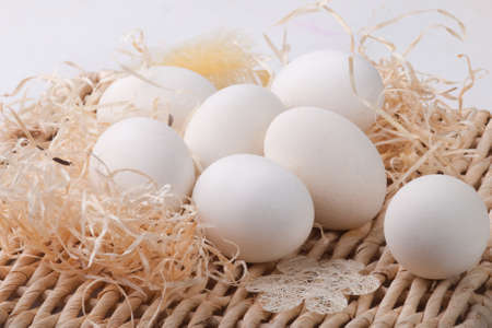 delightfully: White eggs lying on straw support