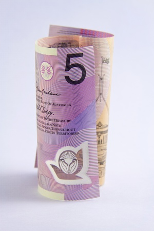 rolled up Australian 5 dollar note on white background