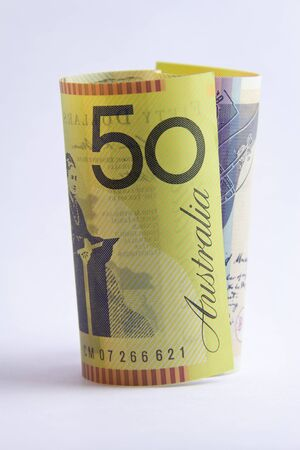 rolled up Australian 50 dollar note on white background Stock Photo