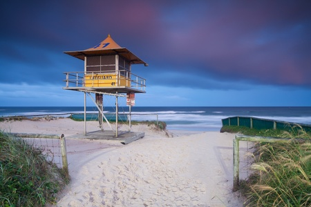lifeguard hut on australian beach with interesting clouds in background photo
