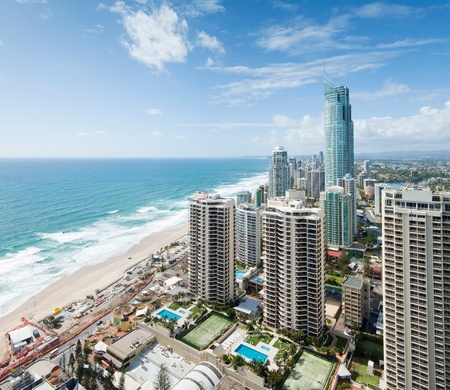 view over the modern city during the day with ocean beside Stock Photo