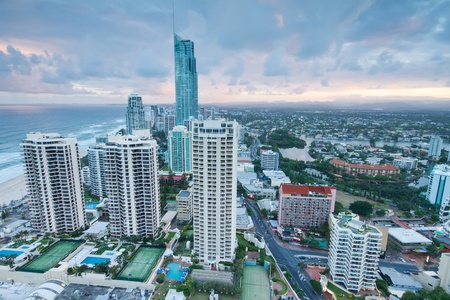 view over the modern city at twilight with ocean beside (gold coast,qld,australia) photo