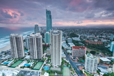 australia beach: view over the modern city at twilight with ocean beside (gold coast,qld,australia) Stock Photo