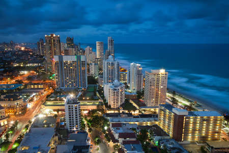 view over the modern city at dusk with ocean beside (gold coast,qld,australia) photo