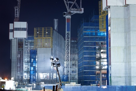 screen system and scaffold on the construction building at night (gold coast,qld,australia,march 2011) Stock Photo