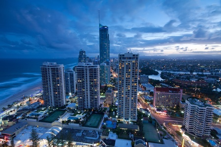 view over the modern city at dusk with ocean beside (gold coast,queensland,australia)