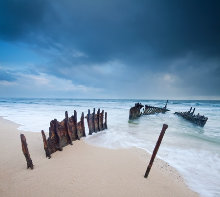 wreck on australian beach at dawn on square format  Stock Photo