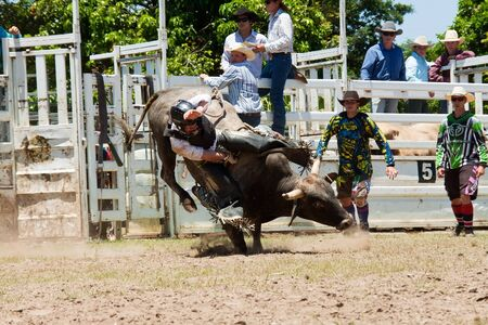 GOLD COAST, AUSTRALIA - JANUARY 26, 2011: Unidentified cowboy rides dangerous bull on January 26,2011 in Gold Coast, Queensland, Australia. The rodeo show was part of Australia Day celebration.