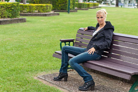 young attractive woman relax in the park photo