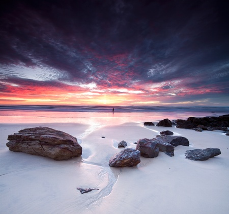 miami sunset: australian seascape at dawn with rocks in foreground (miami beach, queensland, australia) Stock Photo