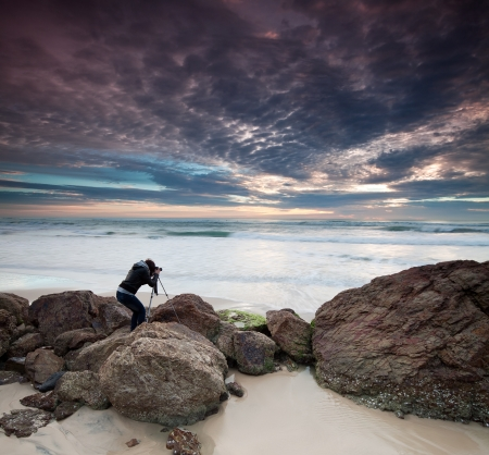 woman photographer takes photo of the beautiful seascape (miami beach, queensland, australia) Stock Photo