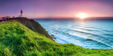 australie landschap: Byron Bay vuurtoren tijdens zonsopgang Stockfoto