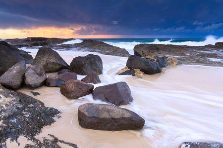 qld: australian seascape at twilight (rainbow bay beach, qld, australia)